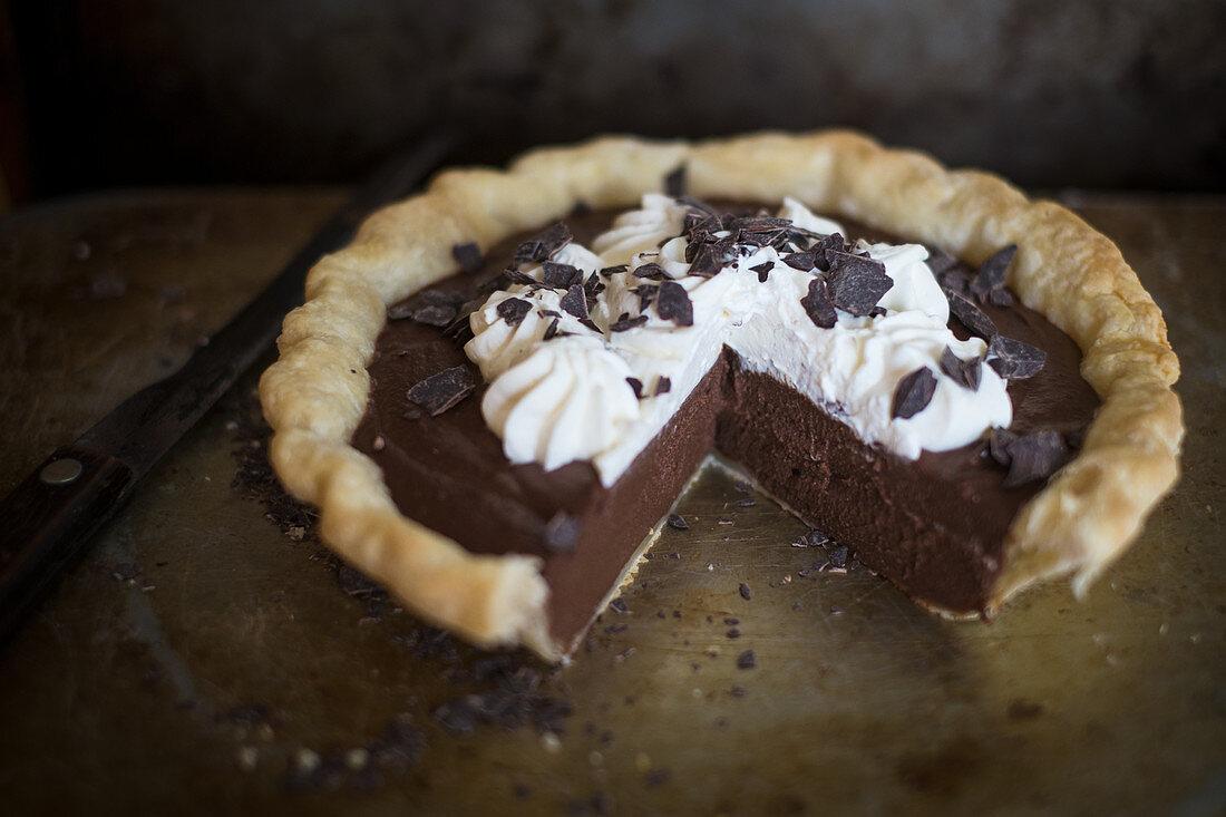 Chocolate pie with cream, sliced