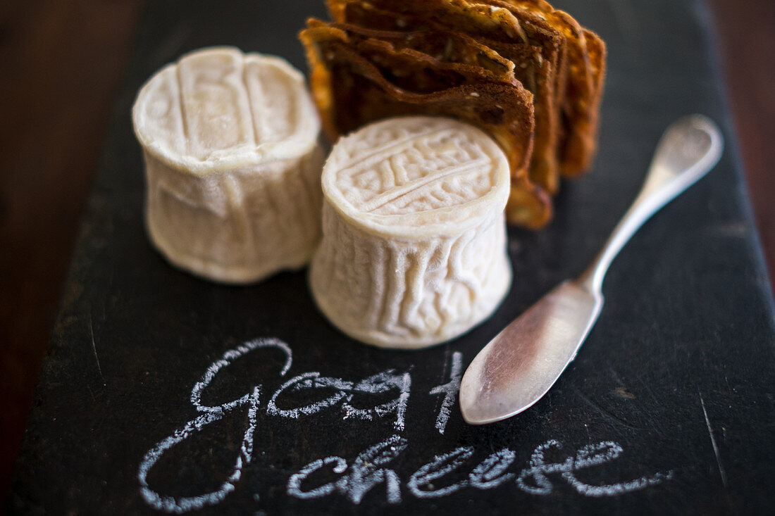 Ripe goat's cheese on a chalkboard with writing