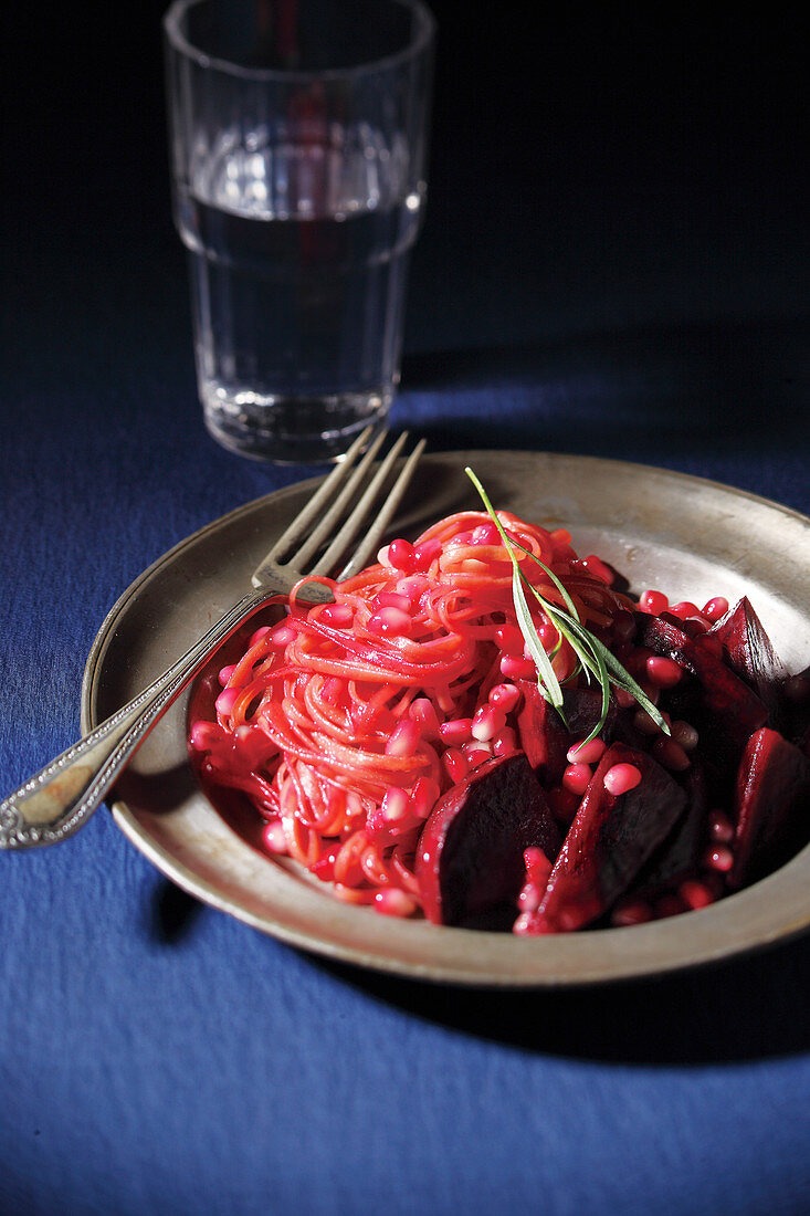 Pomegranate pasta on a pewter plate