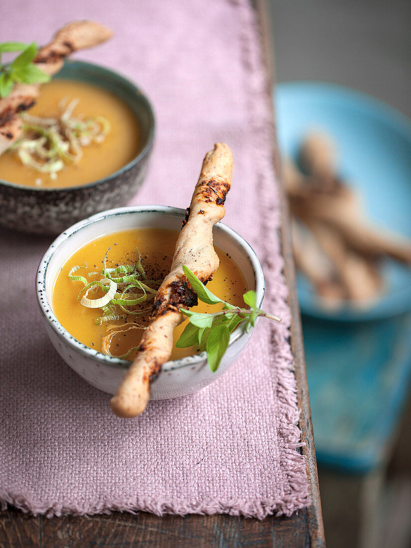 Cream of potato and carrot soup with fresh garlic and almond mousse