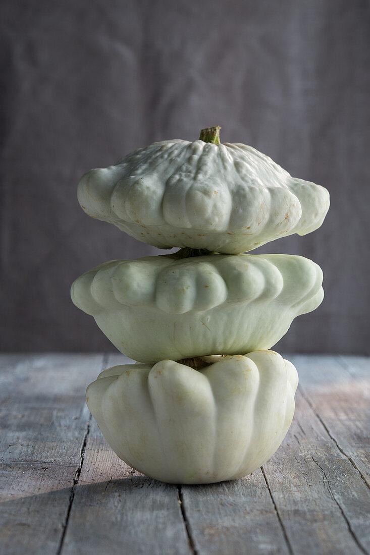 A stack of three patty-pan squash