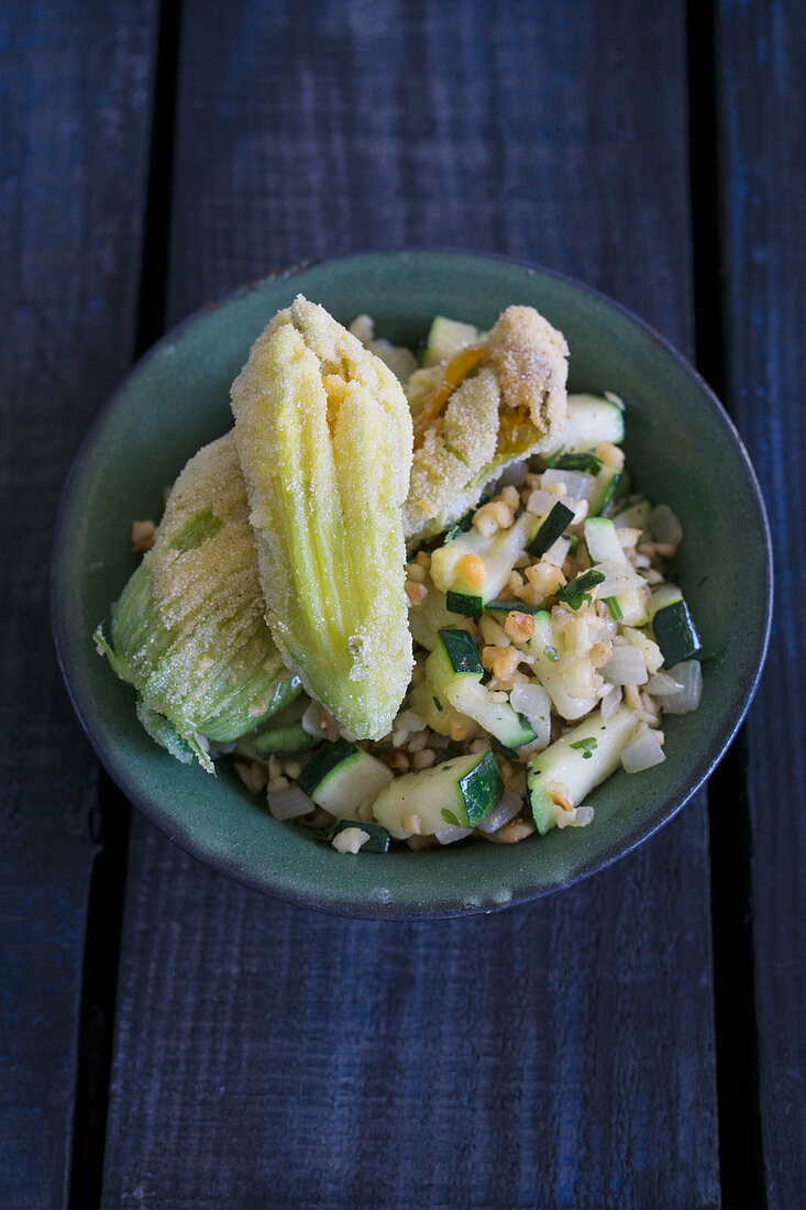 Steamed zucchini with fried zucchini flowers