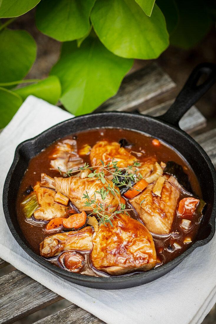 Coq au Vin in a cast iron pan