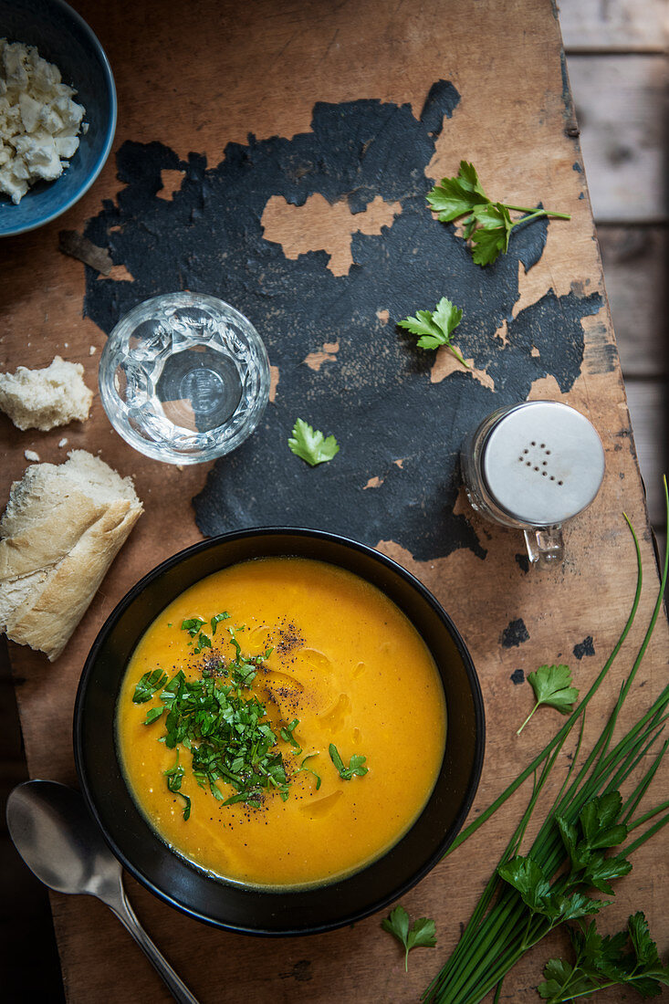 Pumpkin soup with chives and parsley, view from above