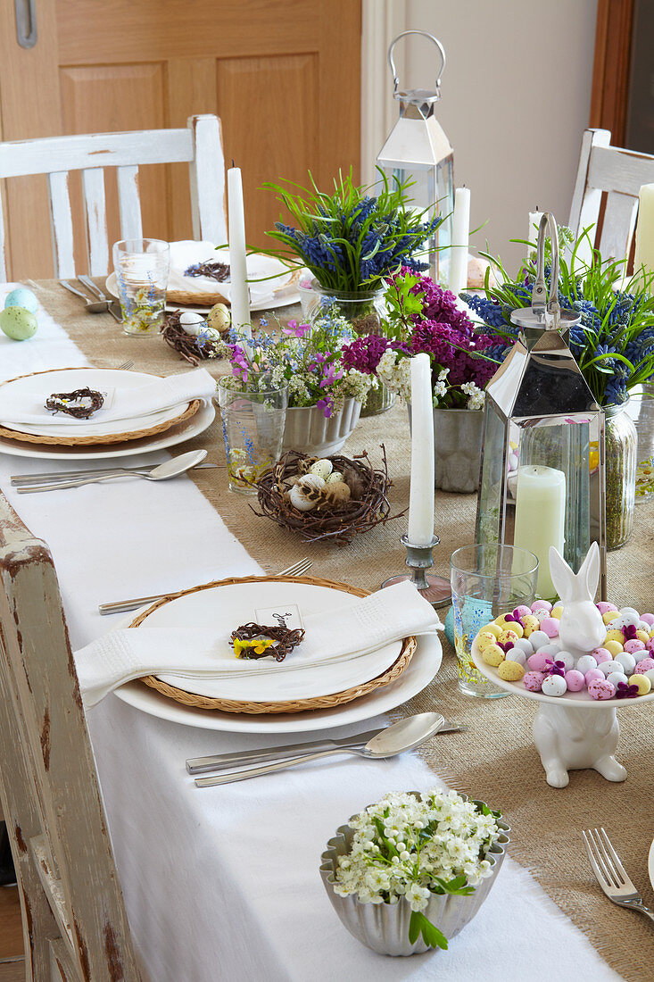 Flower arrangements on festively set Easter table
