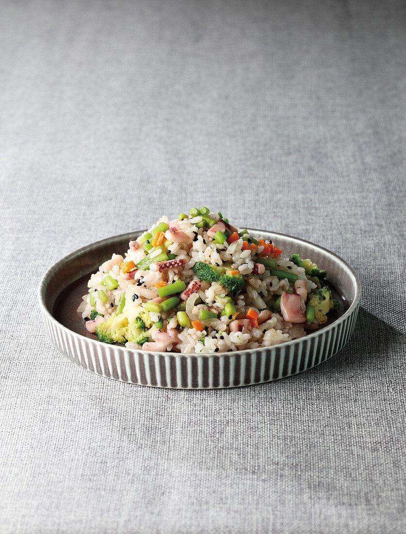 Bokkeumbap (Korean stir-fried rice with squid and garlic stems)