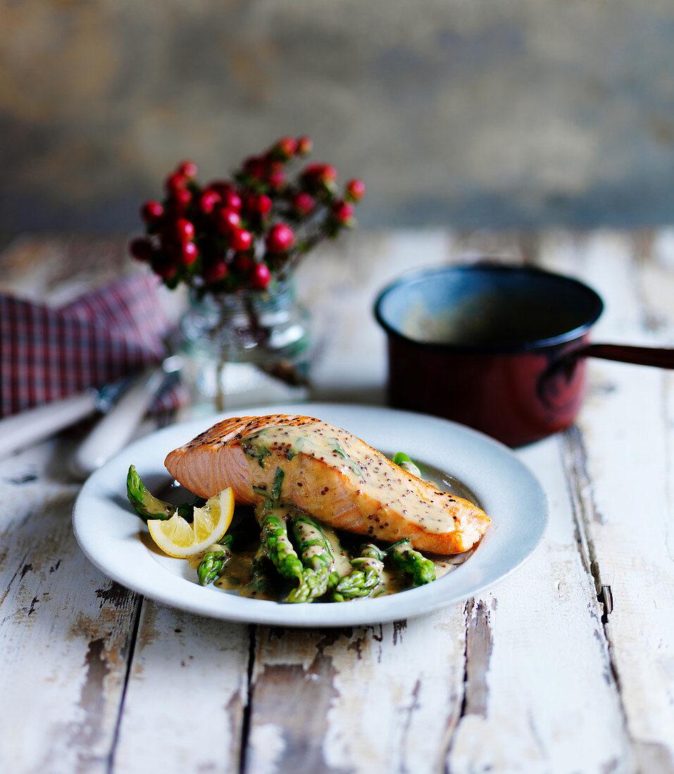Salmon with herb mustard sauce, asparagus and lemon