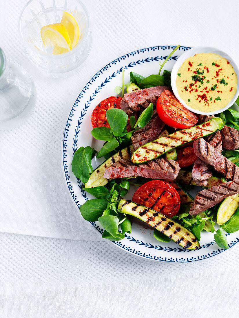 Beef salad with zucchini, tomato and watercress