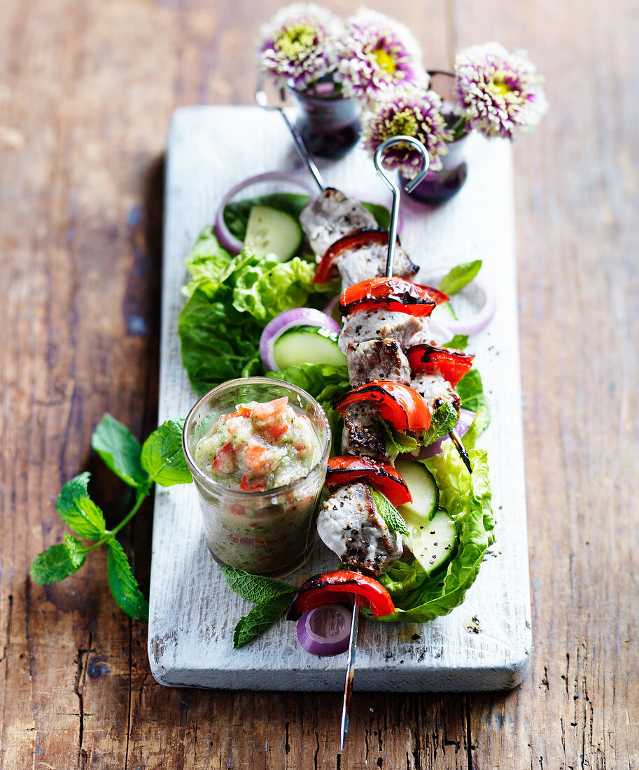 Lamb kebabs with lemons and rosemary served with a dip