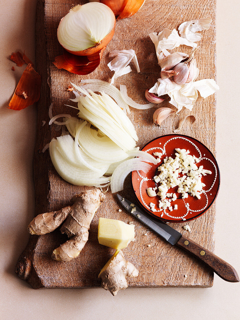Ingredients for a tagine dish (garlic, ginger, onions)