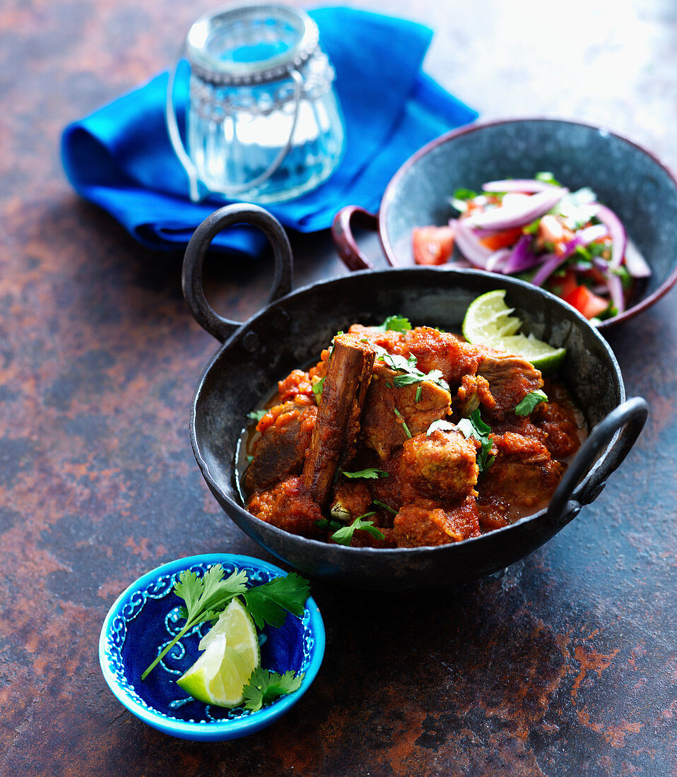 Vindaloo curry with lime and coriander leaves (India)