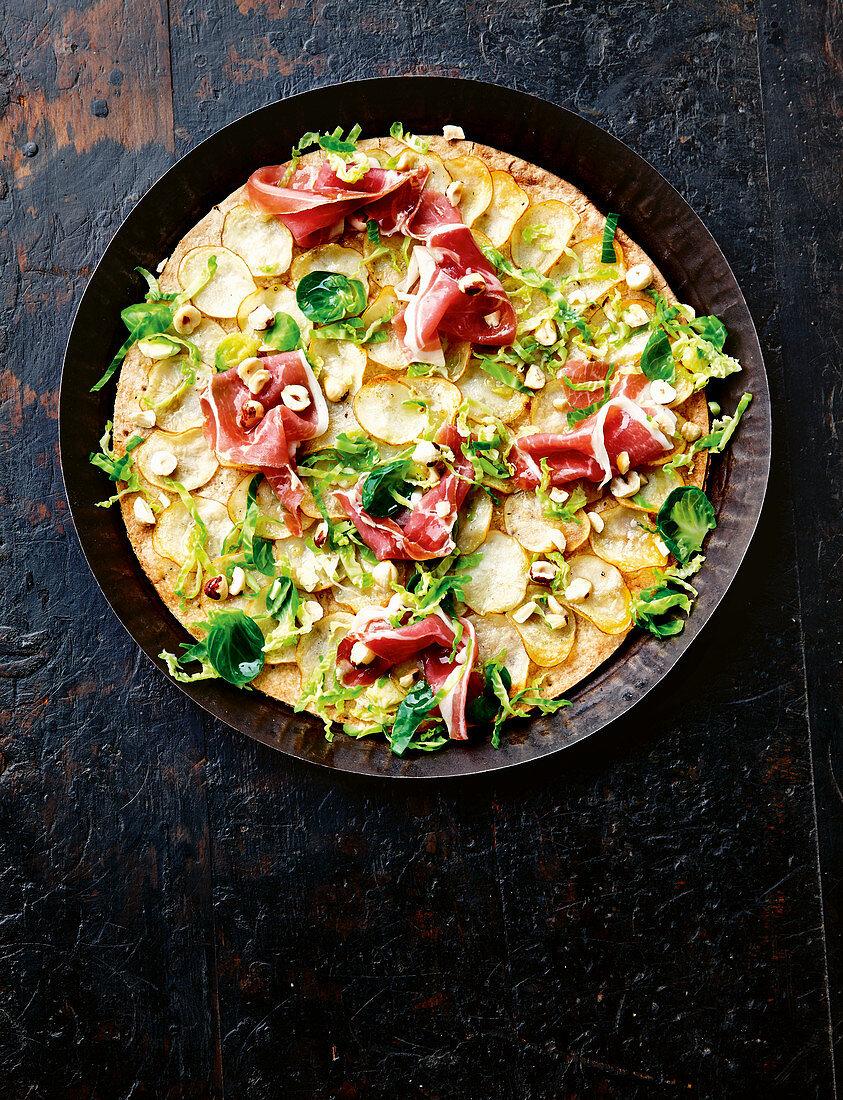 Potato, prosciutto and brussels sprouts pizza