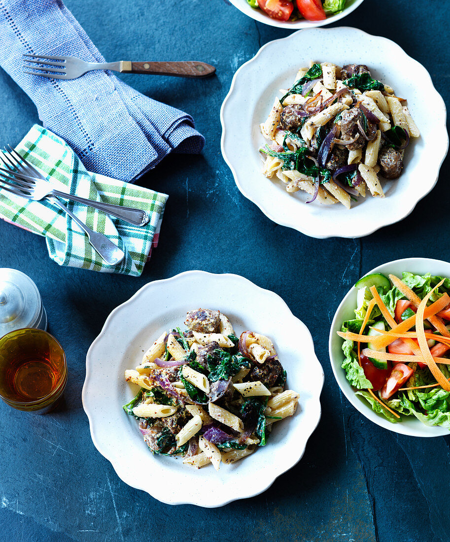 Penne with sausage, onions, mustard seeds and side salads