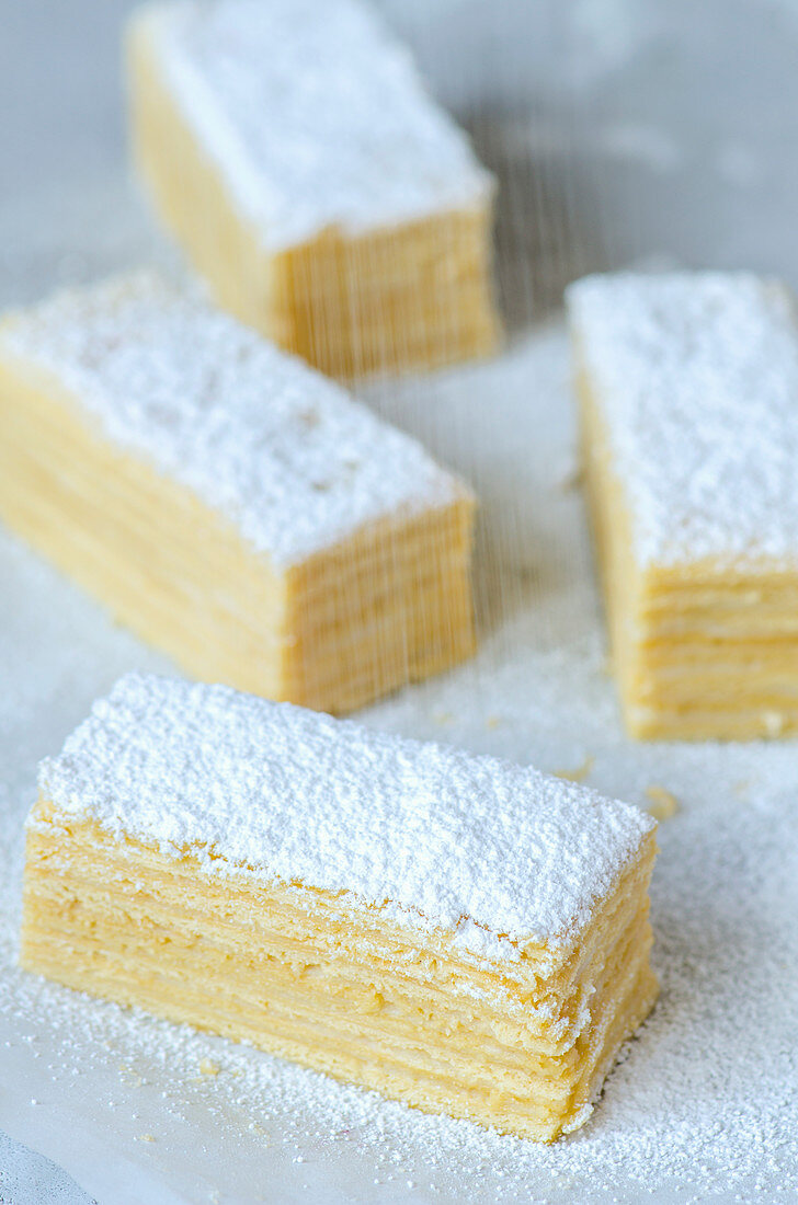 Puff pastry slices sprinkled with icing sugar