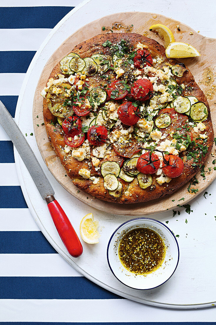 Spiced tomato Afghan pizza with dukkah and feta