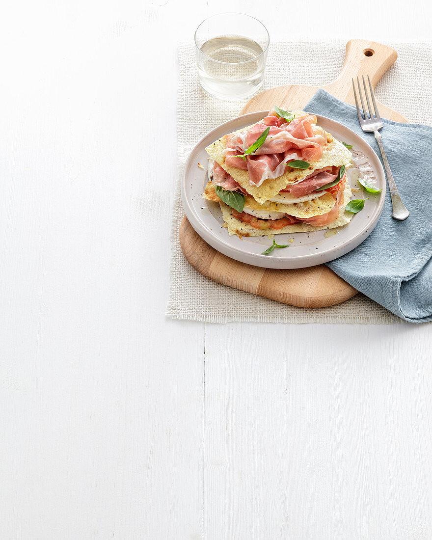 Millefoglie di pane e prosciutto crudo (millefeuille with unleavened bread and raw ham, Italy)