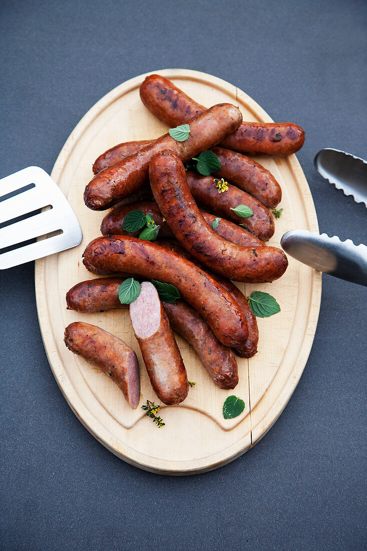 Grilled smoked sausages with kaffir lime and honey
