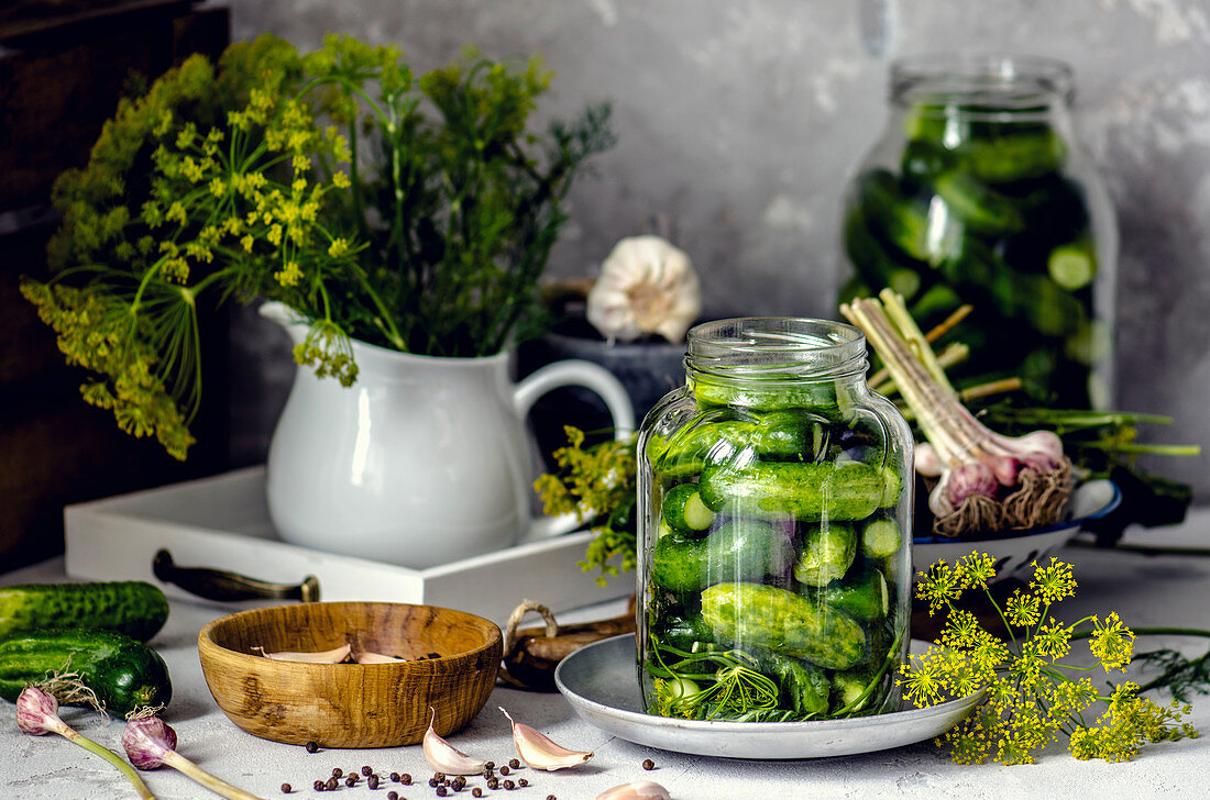 Pickled gherkins in a jar with garlic and dill