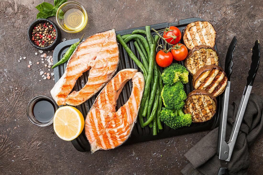 Grilled salmon steak, chicken and vegetables