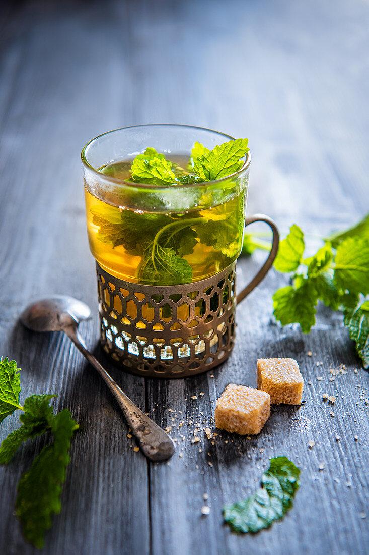 Lemon balm mint tea in a glass