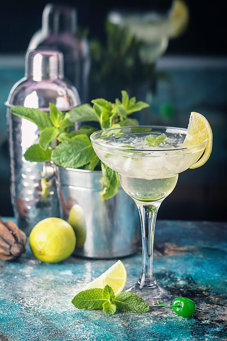 Fresh classic lemon margarita cocktail with ice and mint