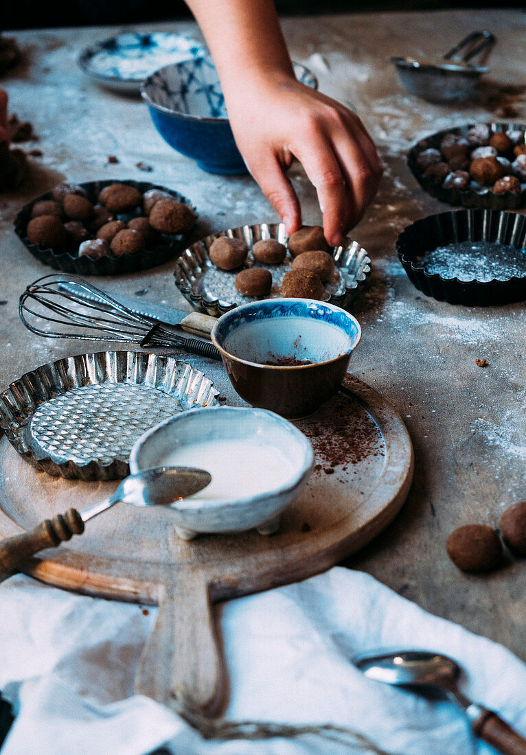 Children baking gingerbread biscuits for St. Nicholas Day