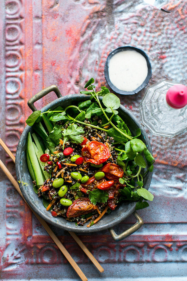 Quinoa salad with edamame, black rice, cucumber, sun-dried tomatoes and watercress