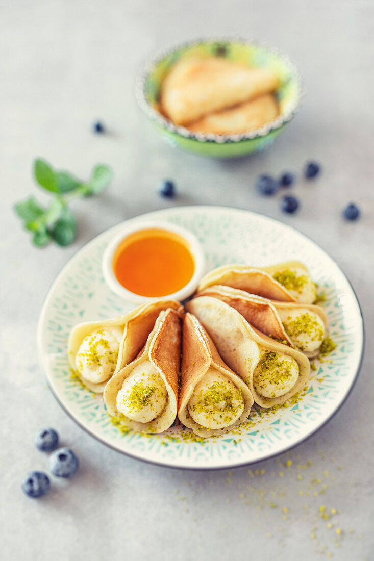 Atayef, small pancakes with semolina cream and orange syrup (Arabia)