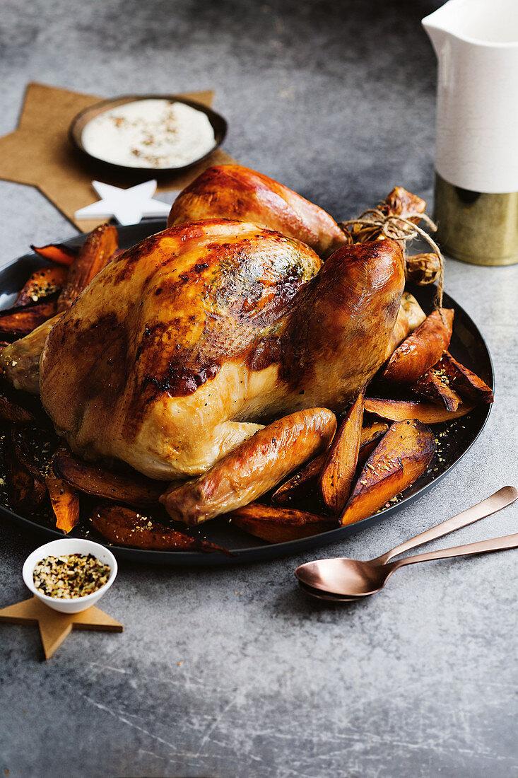 A whole roast turkey with truffle salt and sweet potatoes