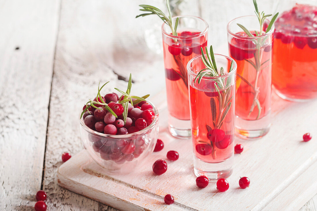 Refreshing drink with cranberries and rosemary