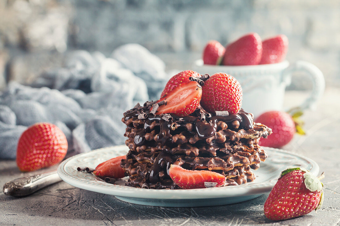 Waffle dessert with chocolate sauce and strawberry