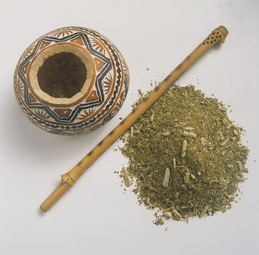 Loose Tea with a Wooden Infuser and Clay Pot