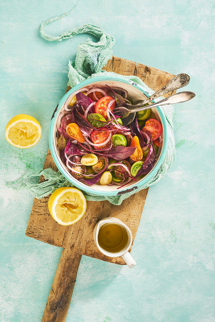 Mixed tomato salad with red onion and red chard