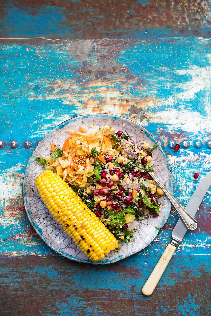 Quinoa salad with chickpeas, kale and corn on the cob