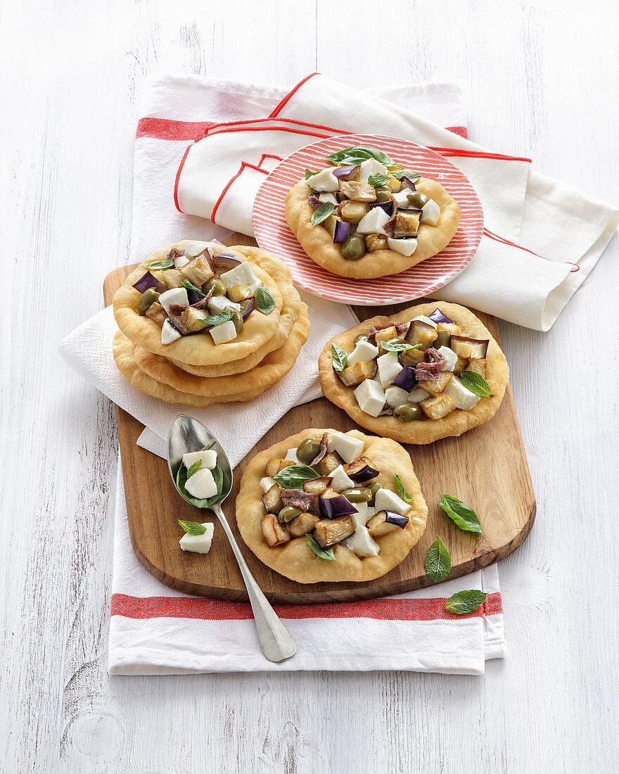 Mini pizzas with aubergines and mozzarella