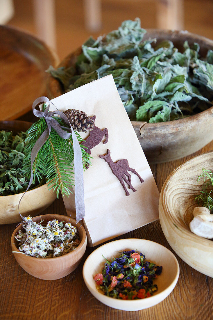 Homemade tea in paper bag decorated with felt deer