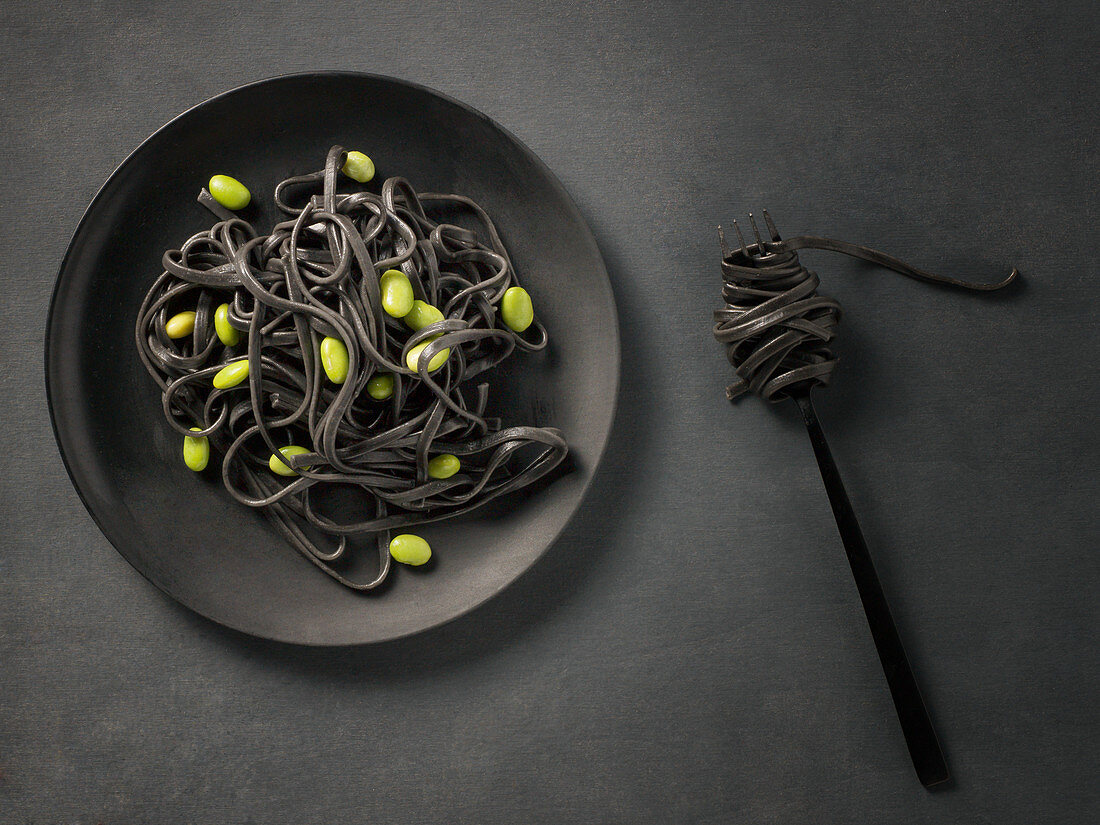 Black pasta with broad beans
