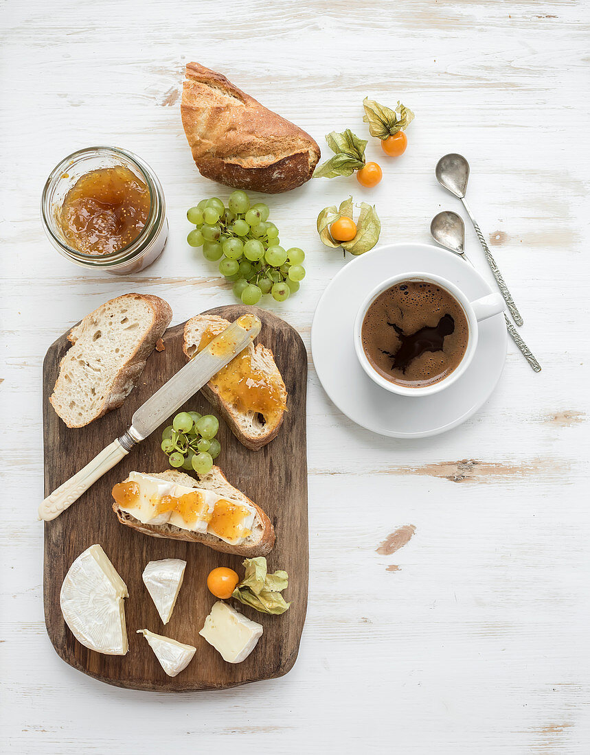 Brie cheese and fig jam sandwiches with fresh grapes and ground cherries