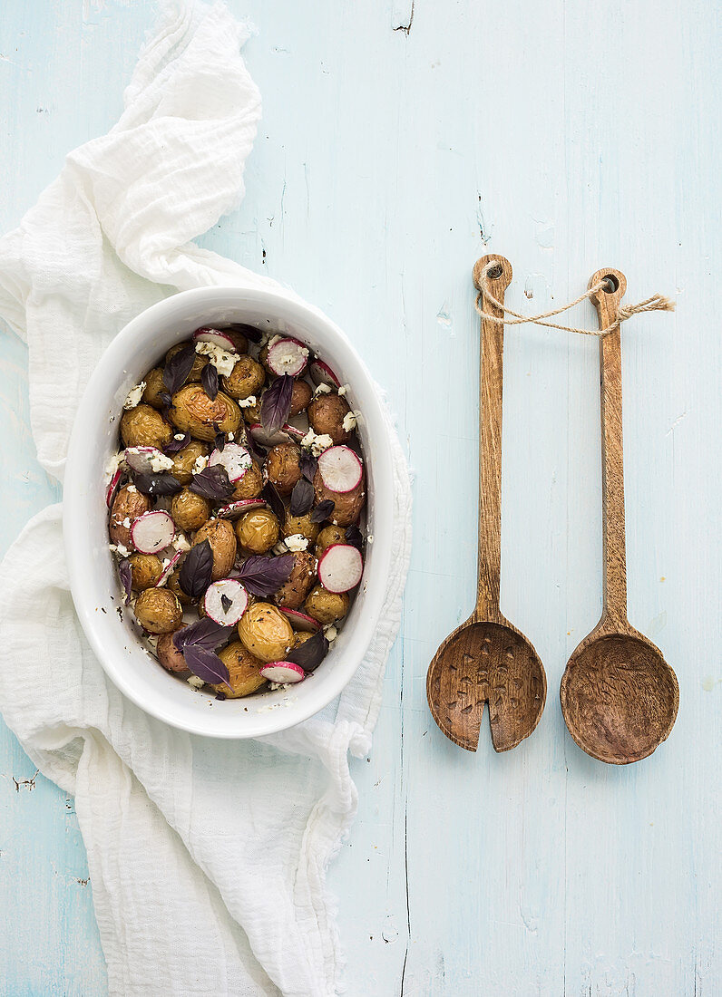 Roast young potato salad with radish and soft cheese