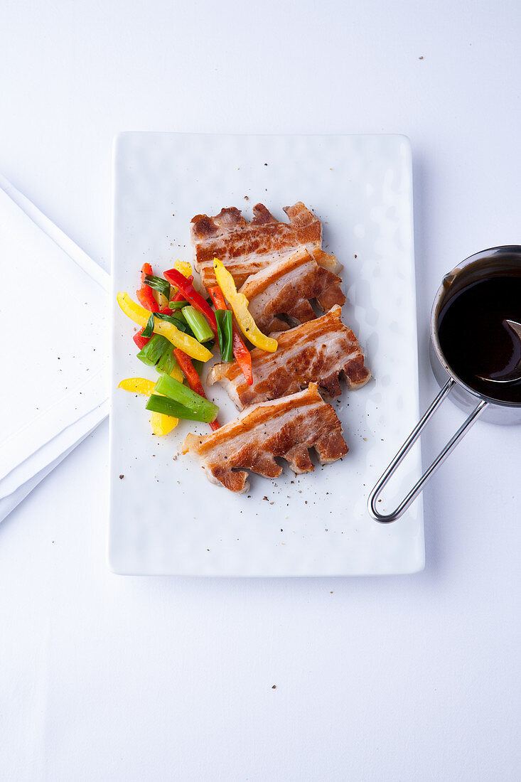 Fried pork belly with peppers