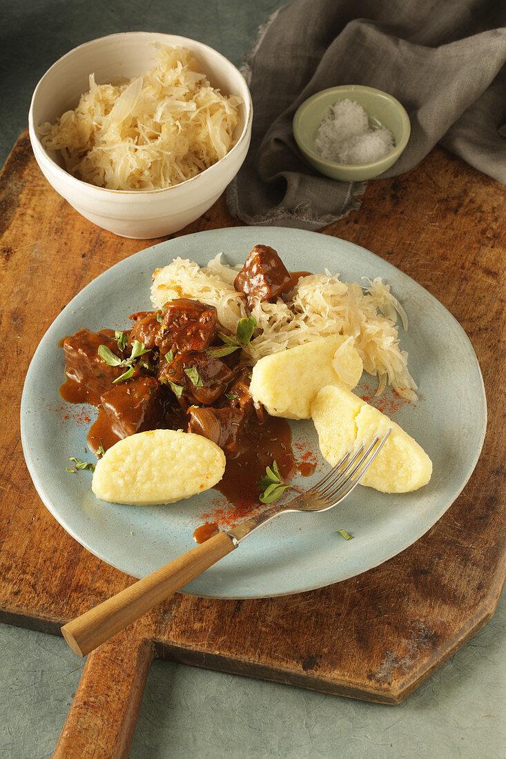 Black beer goulash with potatoes and sauerkraut
