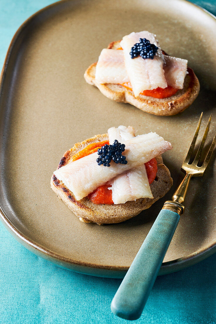 Blinis with fish fillet and caviar