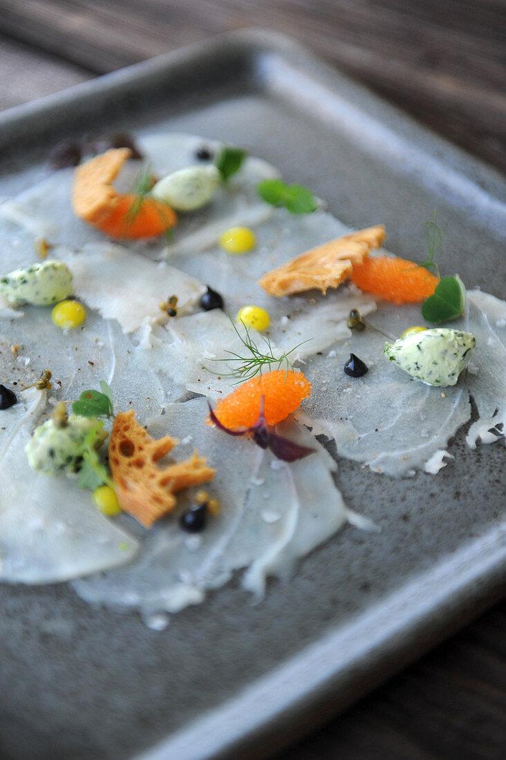 Fish carpaccio with caviar