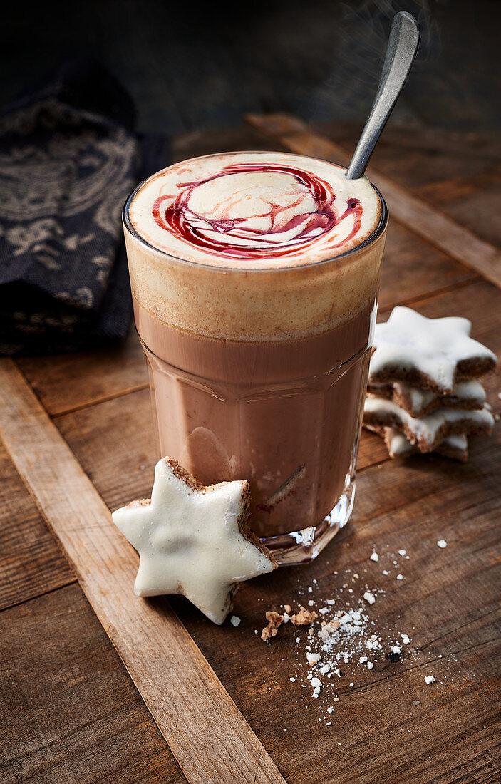 Hot chocolate with cherry sauce and cinnamon stars
