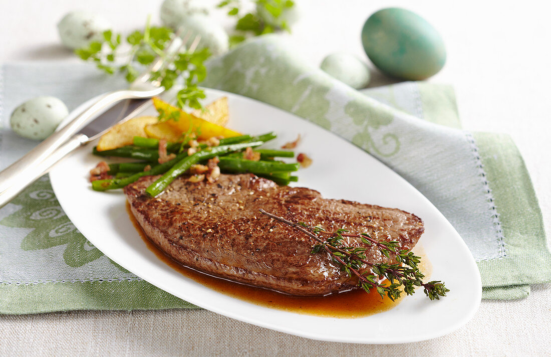 Roast beef flank steak with a bean medley and potato wedges for Easter