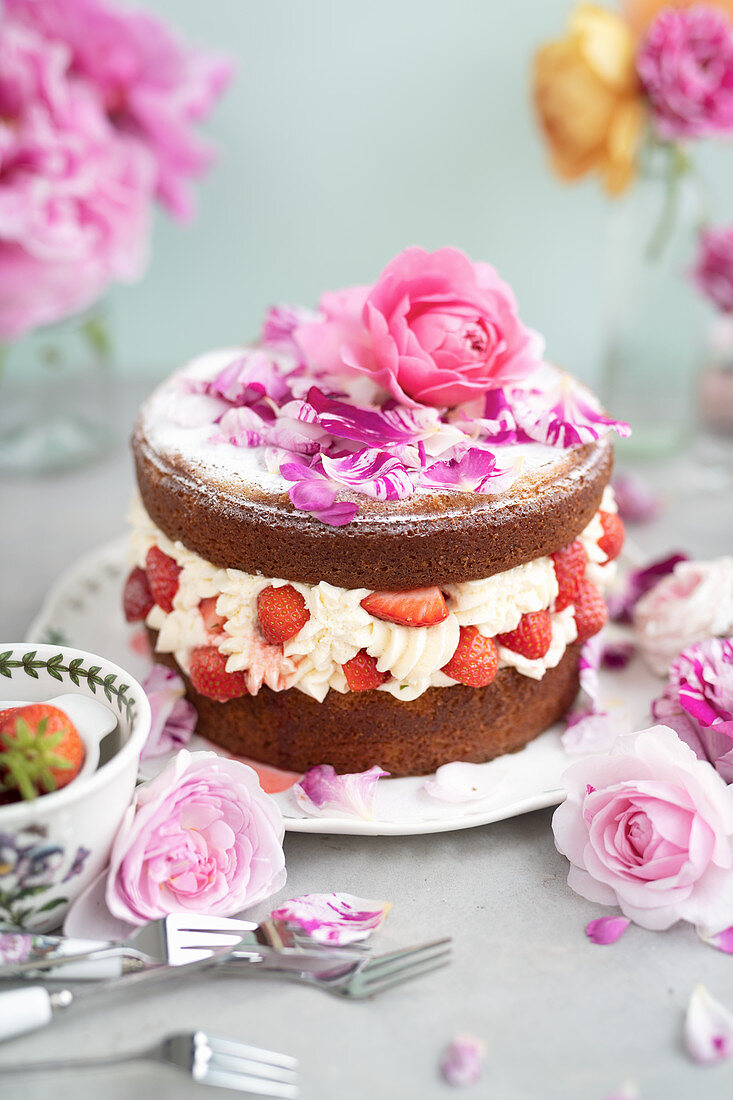 Strawberry rose layer cake filled with whipped cream and strawberries