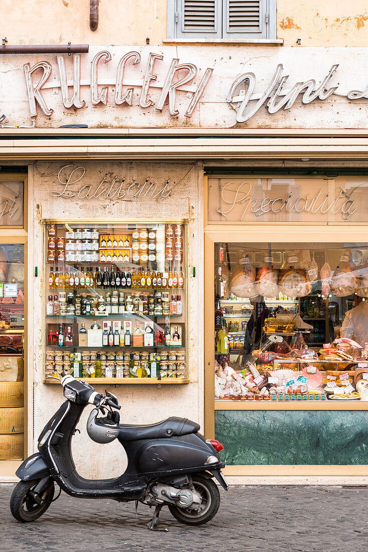 Traditional grocery store with scooter at Campo de Fiori square, Rome, Italy