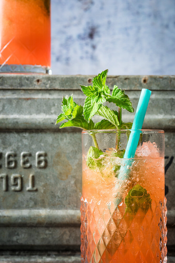 A frozen cocktail made with Aperol, almond syrup, tequila, mezcal and lime syrup