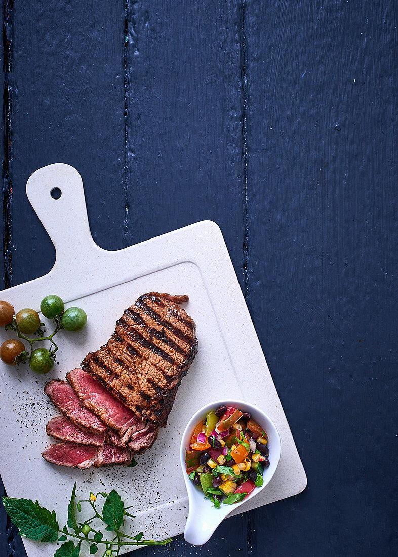 Rib-eye steak with tomato salsa