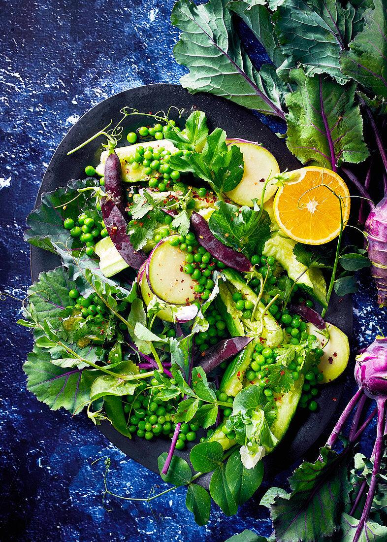 Pea, kohlrabi and smashed cucumber salad with orange dressing
